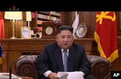 FILE - In this undated image from video distributed Jan. 1, 2019, by North Korean broadcaster KRT, leader Kim Jong Un delivers a speech in North Korea.