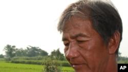 菲律宾的一位农民不久将在手机上获得如何增加稻米产量的建议
