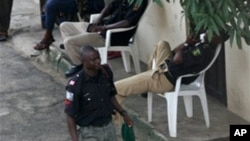 Unidentified policemen on guard duty to provide security against kidnapping rings in Nigeria. (File Photo)