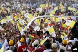 Pope Francis arrives to celebrate Mass in the Kyaikkasan Ground in Yangon, Myanmar, Wednesday, Nov. 29, 2017.