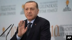 Turkey's President Recep Tayyip Erdogan addresses foreign ambassadors at a Ramadan dinner in Ankara, Turkey, June 6, 2017.