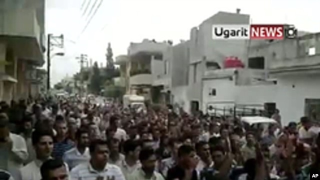 An image taken from footage uploaded on YouTube shows Syrian anti-government protesters flooding the streets of the central city of Hama, July 8, 2011, to demand the fall of the regime President Bashar al-Assad