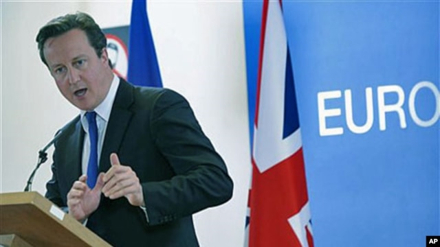 British Prime Minister David Cameron addresses a media conference at an EU summit in Brussels, Belgium, Oct. 23, 2011.
