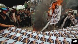 Pembakaran foto Presiden yang mungkin dapat dikenai pasal penghinaan terhadap kepala negara. (Foto: Dok)