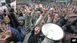 Health sector personnel shout slogans during a protest against austerity measures outside the Health Ministry in Athens, Greece, February 2, 2012.