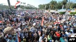 Egyptian supporters of deposed president Mohamed Morsi take part in a demonstration in Morsi's support, near Cairo university, Egypt, July 26, 2013.