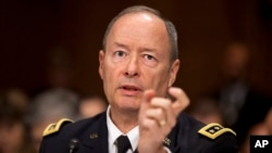 National Security Agency Director Gen. Keith Alexander testifies on Capitol Hill in Washington, Wednesday, Oct. 2, 2013.