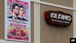 A large poster advertising the movie The Interview hangs on the back wall of the Alamo Drafthouse Cinema Tuesday, Dec. 23, 2014.