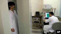 Satomi Kuroki, a 13-year-old junior high school student, receives a whole-body counter radiation check at Minimisoma City General Hospital just outside the 20-kilometer Fukushima Prefecture, Japan, March 7, 2012.