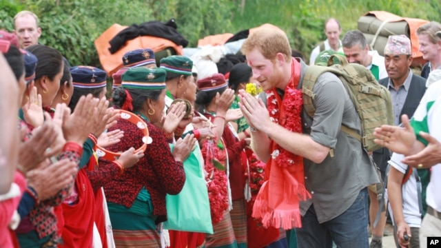 A handout photo provided by National News Agency of Nepal, shows Britain's Prince Harry as he is welcomed by villagers upon his arrival in Lamjung, Nepal, March 21, 2016.
