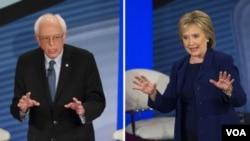 Senator Berni Sanders i bivša državna sekretarka Hilari Klinton na sinoćnjem susretu sa glasačima