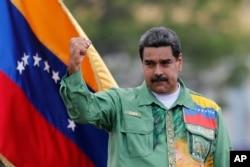 Venezuela's President Nicolas Maduro raises his fist during a closing campaign rally in Caracas, May 17, 2018.