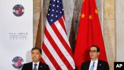 Chinese Vice Premier Wang Yang, left, and Treasury Secretary Steven Mnuchin, attend the U.S.-China Comprehensive Economic Dialogue at the Treasury Department in Washington, July 19, 2017.