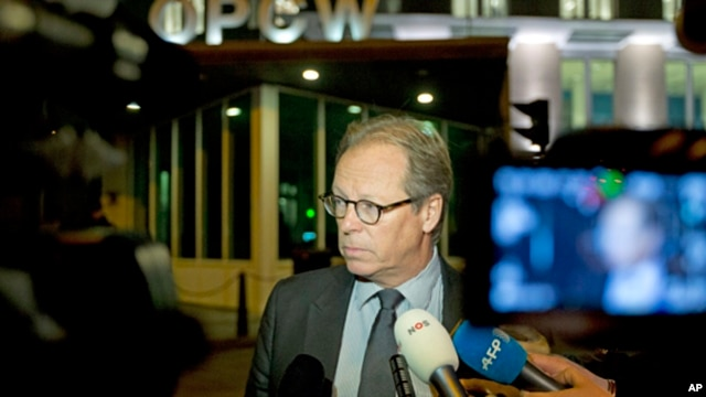 Spokesman Michael Luhan gives a brief statement outside the headquarters of the Organization for the Prohibition of Chemical Weapons, OPCW, in The Hague, Netherlands, Sept. 27, 2013.