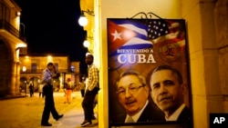"A sign at a restaurant in Havana, Cuba shows Cuban President Raul Castro, left, and U.S. President Barack Obama. It says ""Welcome to Cuba"" in Spanish. March 17, 2016."