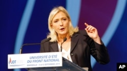 FILE - Leader of France's far-right National Front party Marine Le Pen is seen delivering a speech in Marseille, France, Sep. 6, 2015. Le Pen has admitted her party received an $11-million loan from a Russian-owned bank.