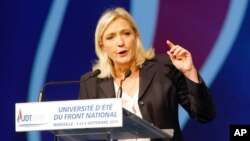 FILE - The National Front's Marine Le Pen, shown delivering a speech in Marseille, France, in September, would lose a runoff in the northern region of Nord-Pas-de-Calais-Picardie, a poll shows.