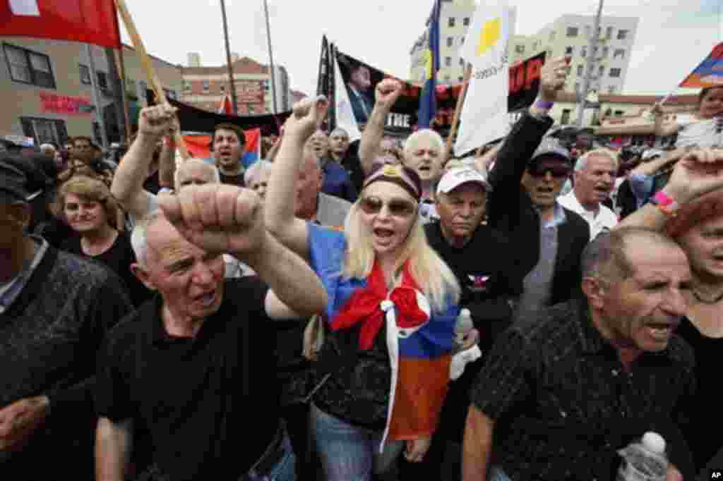 Thousands of demonstrators march Tuesday April 24, 2012 to mark the death of 1.5 million Armenians in the former Ottoman empire, in Los Angeles. The demonstration is an annual remembrance of the killings of Armenians in the Turkish territories during Worl