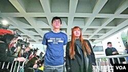 青年新政梁颂恒和游惠桢在高等法院 (苹果日报图片)