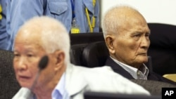 FILE - Former Khmer Rouge leaders Noun Chea and Khieu Samphan in court.