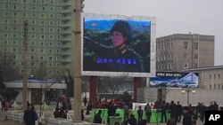 A military-themed movie is broadcast on a large TV screen near the train station in Pyongyang, North Korea, April 10, 2012.