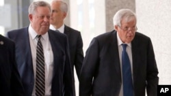 Former U.S. House Speaker Dennis Hastert, right, departs the federal courthouse in Chicago with attorney Thomas Green after his arraignment on charges that he broke federal banking laws and lied about the money when questioned by the FBI, June 9, 2015.