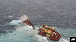 The stricken container ship Rena sits on a reef about 14 nautical miles (22 km) from Tauranga, on the east coast of New Zealand's North Island after it separated into two, January 8, 2012.