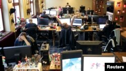 Coders work in the Mojang company office in Stockholm, Sweden, Jan. 21, 2013.