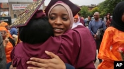 Brooklyn College humanities and social sciences graduate Ameera Badamasi, center, from Nigeria, hugs a student after the college's commencement ceremony, where Sen. Bernie Sanders, I-Vt., delivered the keynote address, May 30, 2017.