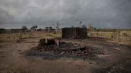Hundreds of homes like this one were burned to the ground, and 38 people died in the massacre, carried out by Pokomo militia, in Kilelengwani, Kenya, September 2012. (VOA - R. Gogineni)