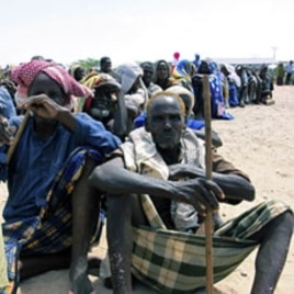 Somali's wait for food aid to be handed out from the UNHCR in Mogadishu , Wednesday. Aug. 31.2011