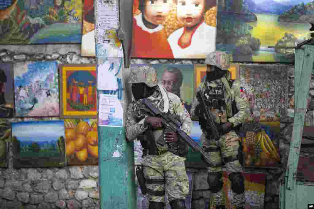 Soldiers patrol in Petion Ville, the neighborhood where the late Haitian President Jovenel Moise lived in Port-au-Prince.