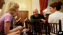 Humanist chaplain Bart Campolo, center, a former Evangelical Christian youth minister, and his wife, Marty, right, mingle with students before a forum at the University of Southern California in Los Angeles, Jan. 28, 2015.