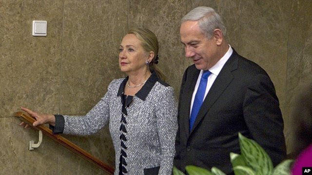 Israel's Prime Minister Benjamin Netanyahu walks with U.S. Secretary of State Hillary Rodham Clinton upon her arrival to their meeting in Jerusalem, Nov. 20, 2012.
