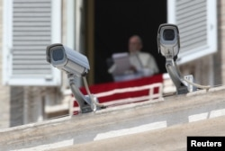 Security cameras are seen in front of Pope Francis as he leads a Sunday Angelus prayer in Saint Peter's square at the Vatican, Aug. 20, 2017.