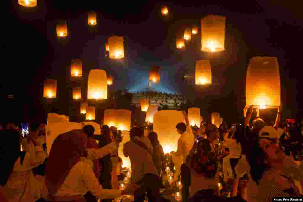 Visitors release paper lanterns to celebrate Vesak Day at the Borobudur temple in Magelang, Central Java province, Indonesia.