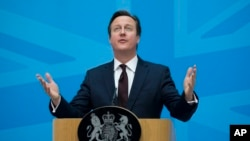FILE - British Prime Minister David Cameron delivers a speech at the Home Office in London, May 21, 2015.
