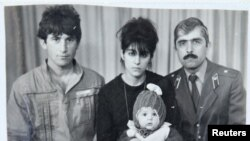 Pictured is Tamerlan (C, bottom) Tsarnaev, accompanied by his father Anzor (L), mother Zubeidat and uncle Muhamad Suleimanov (R), in this photo courtesy of the Suleimanova family.