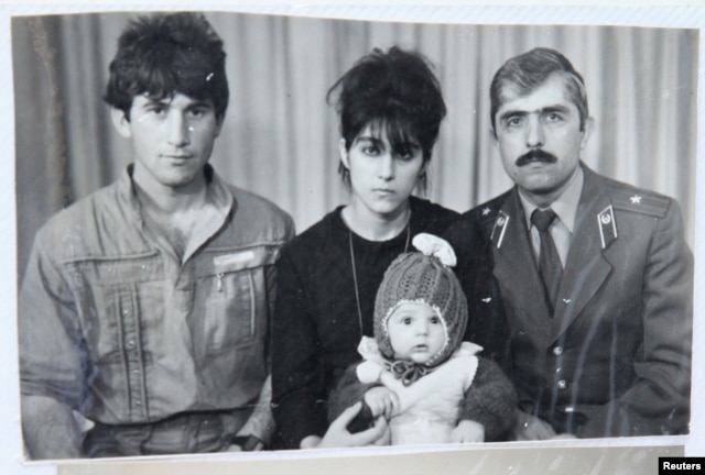 Pictured is Tamerlan (C) Tsarnaev, accompanied by his father Anzor (L), mother Zubeidat and uncle Muhamad Suleimanov (R), in this photo courtesy of the Suleimanova family.