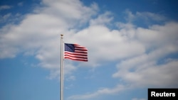 FILE - A U.S. flag is seen in Normal, Ill., March 30, 2011.