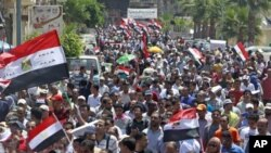 Egyptians chant slogans against the government and military rulers after Friday prayers, 230 kilometers north of Cairo, in Alexandria, Egypt, July 15, 2011