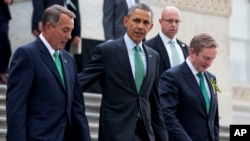 "FILE - From left, House Speaker John Boehner of Ohio, President Barack Obama and Irish Prime Minister Enda Kenny leave a ""Friends of Ireland"" luncheon on Capitol Hill in Washington, March 17, 2015."