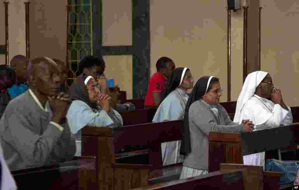 Kenyan Christians and nuns offer prayers at Holy Family Cathedral during Christmas Mass in Nairobi, Dec. 25, 2013.