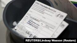 USA, Seatle, Washington, A Pfizer coronavirus disease (COVID-19) vaccine card is seen at a mass vaccination site