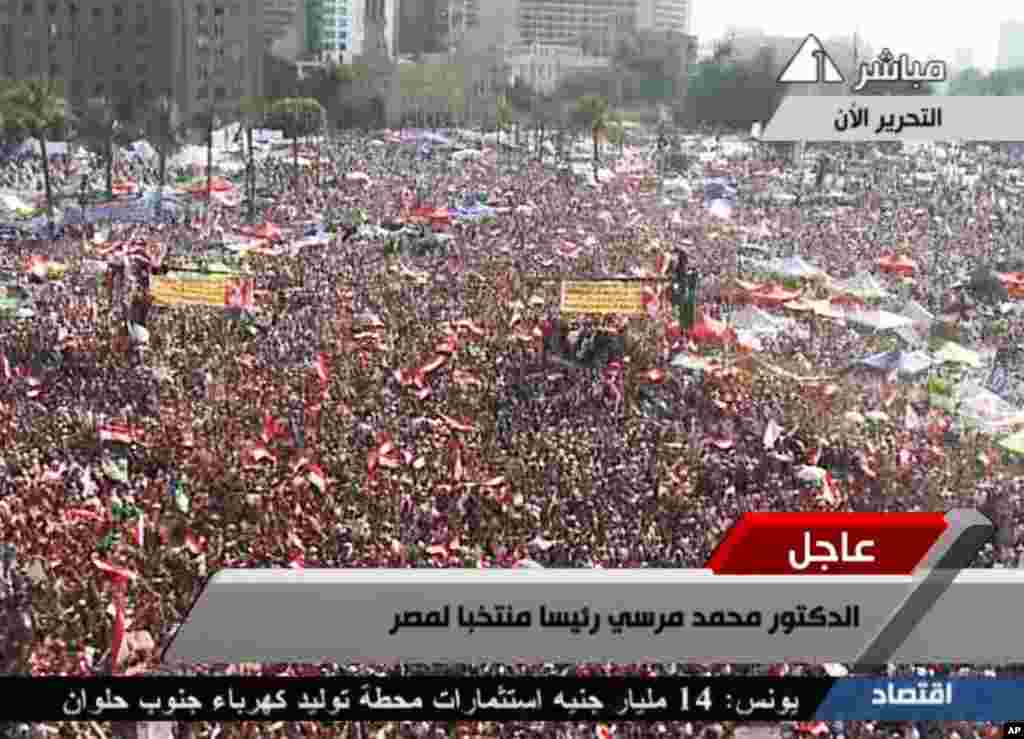 In this image taken from Egypt State TV, Supporters of Muslim Brotherhood President Mohammed Morsi react to the announcement of his victory in Tahrir Square in Cairo, Egypt, June 24, 2012. (Reuters)