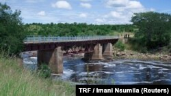 FILE - The Ruaha river water passes under a bridge in Kilolo district, Tanzania, June 14, 2017.