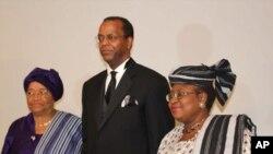 President Ellen Johnson Sirleaf of Liberia, Africare President Darius Mans and World Bank managing director Ngozi Okonjo-Iweala of Nigeria