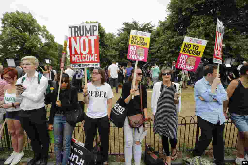 Protesters against the visit of U.S. President Donald Trump gather near an entrance to the American ambassador's residence, Winfield House, in the Regents Park section of London.