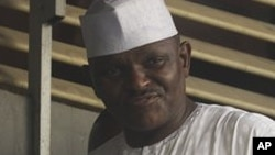Maj. Hamza Al-Mustapha leaves the court after a verdict in Lagos, Nigeria, on Monday, Jan. 30, 2012.