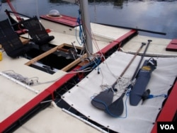 Team Puffin has alternate methods of propulsion for their Wharram Tiki 21 catamaran. (Tom Banse/VOA)